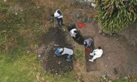 Labores de exhumación en el cementerio de Dabeiba.