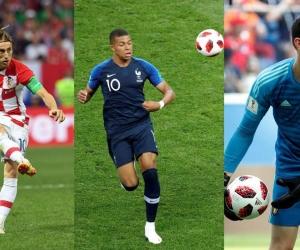 El croata Luka Modric, el francés Kylian Mbappe y el belga Thibaut Courtois