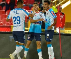 Teófilo Gutiérrez, Fabián Sambueza y Luis Díaz, celebrando el empate.